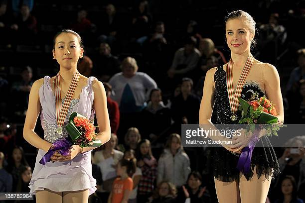 Mao Asada of Japan and Ashley Wagner stand on the victory podium after the Ladies Competition during the ISU Four Continents Figure Skating...