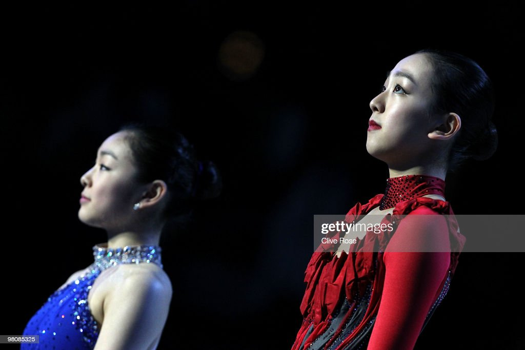 <a gi-track='captionPersonalityLinkClicked' href=/galleries/search?phrase=Mao+Asada&family=editorial&specificpeople=247229 ng-click='$event.stopPropagation()'>Mao Asada</a> of Japan and Yu-Na Kim of Korea look on from the podium after winning the Ladies Free Skate during the 2010 ISU World Figure Skating Championships on March 27, 2010 at the Palevela in Turin, Italy.