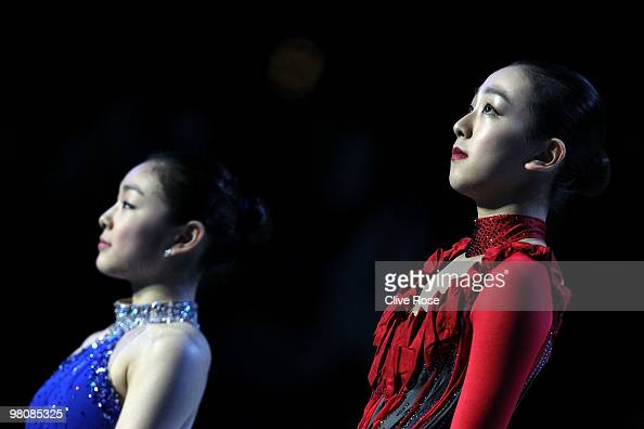 Mao Asada of Japan and YuNa Kim of Korea look on from the podium after winning the Ladies Free Skate during the 2010 ISU World Figure Skating...