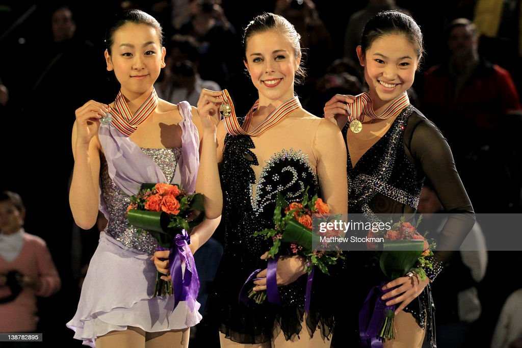 <a gi-track='captionPersonalityLinkClicked' href=/galleries/search?phrase=Mao+Asada&family=editorial&specificpeople=247229 ng-click='$event.stopPropagation()'>Mao Asada</a> of Japan, <a gi-track='captionPersonalityLinkClicked' href=/galleries/search?phrase=Ashley+Wagner&family=editorial&specificpeople=2564533 ng-click='$event.stopPropagation()'>Ashley Wagner</a> and <a gi-track='captionPersonalityLinkClicked' href=/galleries/search?phrase=Caroline+Zhang&family=editorial&specificpeople=4125419 ng-click='$event.stopPropagation()'>Caroline Zhang</a> pose for photographers on the victory podium after the Ladies Competition during the ISU Four Continents Figure Skating Championships at World Arena on February 11, 2012 in Colorado Springs, Colorado.