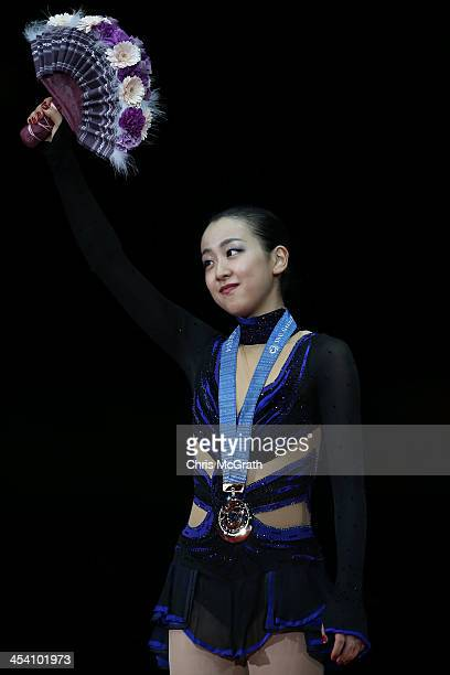 Mao Asada of Japan celebrates after receiving her medal during the victory ceremony for the Ladies Free Skating Final on day three of the ISU Grand...