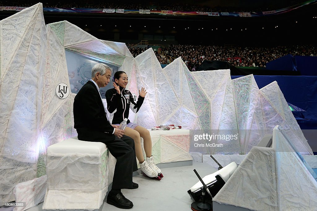 Mao Asada of Japan celebrates her score with her coach Nobuo Sato after her routine in the Ladies Short Program during ISU World Figure Skating...