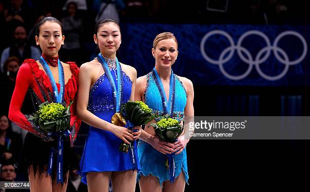 Mao Asada of Japan celebrates the silver medal Kim YuNa of South Korea the gold medal and Joannie Rochette of Canada the bronze medal during the...