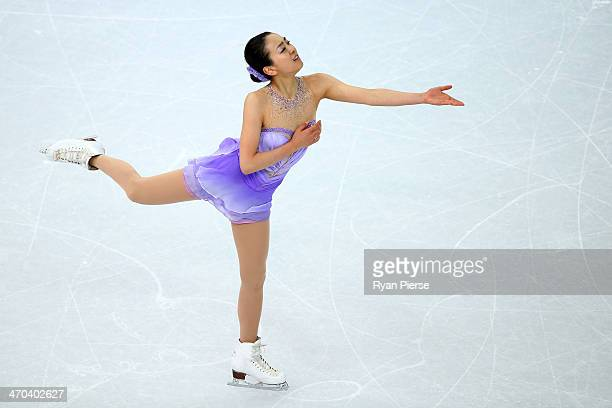 Mao Asada of Japan competes in the Figure Skating Ladies' Short Program on day 12 of the Sochi 2014 Winter Olympics at Iceberg Skating Palace on...
