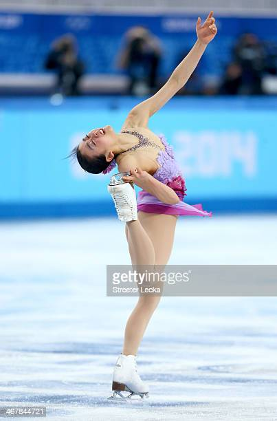 Mao Asada of Japan competes in the Figure Skating Team Ladies Short Program during day one of the Sochi 2014 Winter Olympics at Iceberg Skating...