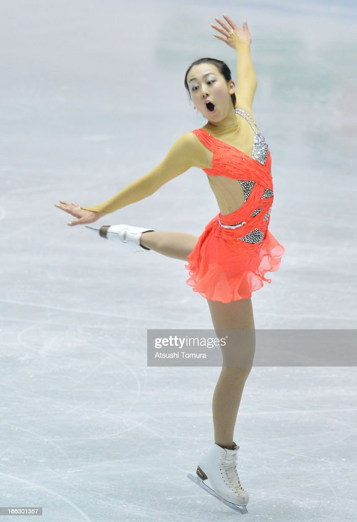 <a gi-track='captionPersonalityLinkClicked' href=/galleries/search?phrase=Mao+Asada&family=editorial&specificpeople=247229 ng-click='$event.stopPropagation()'>Mao Asada</a> of Japan competes in the ladies's short program during day one of the ISU World Team Trophy at Yoyogi National Gymnasium on April 11, 2013 in Tokyo, Japan.
