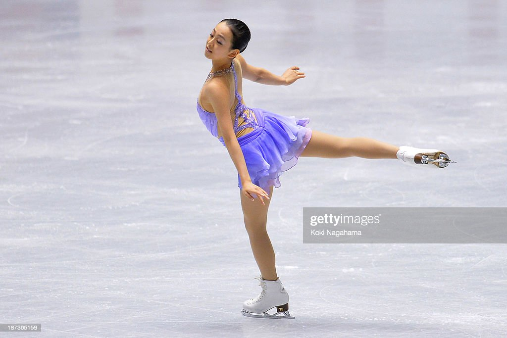 <a gi-track='captionPersonalityLinkClicked' href=/galleries/search?phrase=Mao+Asada&family=editorial&specificpeople=247229 ng-click='$event.stopPropagation()'>Mao Asada</a> of Japan competes in the women's short program during day one of ISU Grand Prix of Figure Skating 2013/2014 NHK Trophy at Yoyogi National Gymnasium on November 8, 2013 in Tokyo, Japan.