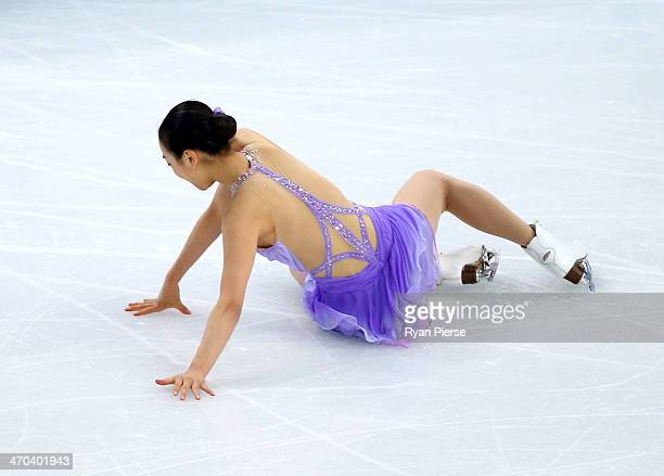 Mao Asada of Japan falls while competing in the Figure Skating Ladies' Short Program on day 12 of the Sochi 2014 Winter Olympics at Iceberg Skating...