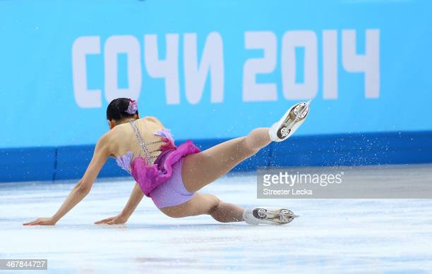 Mao Asada of Japan falls while competing in the Figure Skating Team Ladies Short Program during day one of the Sochi 2014 Winter Olympics at Iceberg...