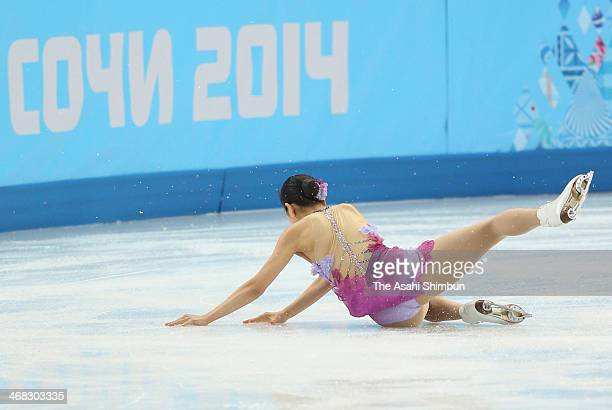Mao Asada of Japan gets up after falling in the Figure Skating Team Ladies Short Program during day one of the Sochi 2014 Winter Olympics at Iceberg...