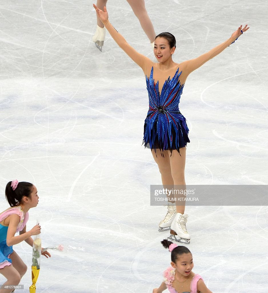 Mao Asada of Japan greets fans after her performance during her women's singles free skating event at the world figure skating championships in Saitama, on March 29, 2014.