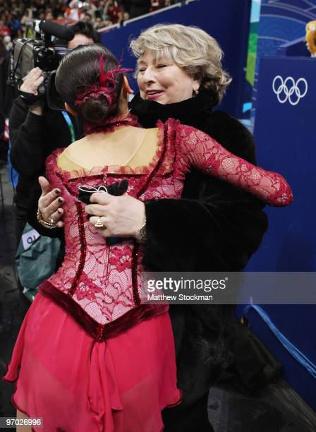 Mao Asada of Japan is greeted by one of her coaches Tatiana Tarasova after performing in the Ladies Short Program Figure Skating on day 12 of the...