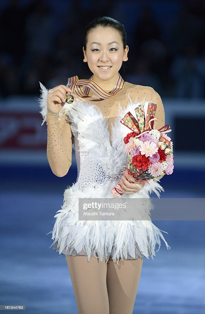 Mao Asada of Japan pose after the medals ceremony during day three of the ISU Four Continents Figure Skating Championships at Osaka Municipal Central Gymnasium on February 10, 2013 in Osaka, Japan.