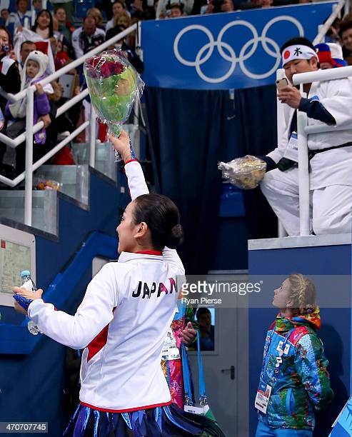Mao Asada of Japan reacts after receiving her score in the Figure Skating Ladies' Free Skating on day 13 of the Sochi 2014 Winter Olympics at Iceberg...