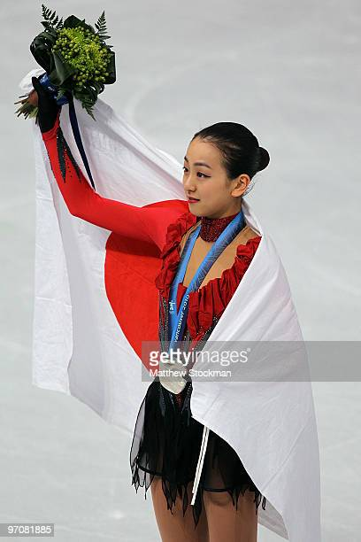 Mao Asada of Japan receives the silver medal during the medal ceremony for the Ladies Free Skating on day 14 of the 2010 Vancouver Winter Olympics at...