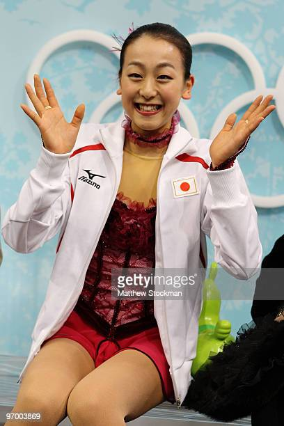 Mao Asada of Japan sits in the kiss and cry area in the Ladies Short Program Figure Skating on day 12 of the 2010 Vancouver Winter Olympics at...