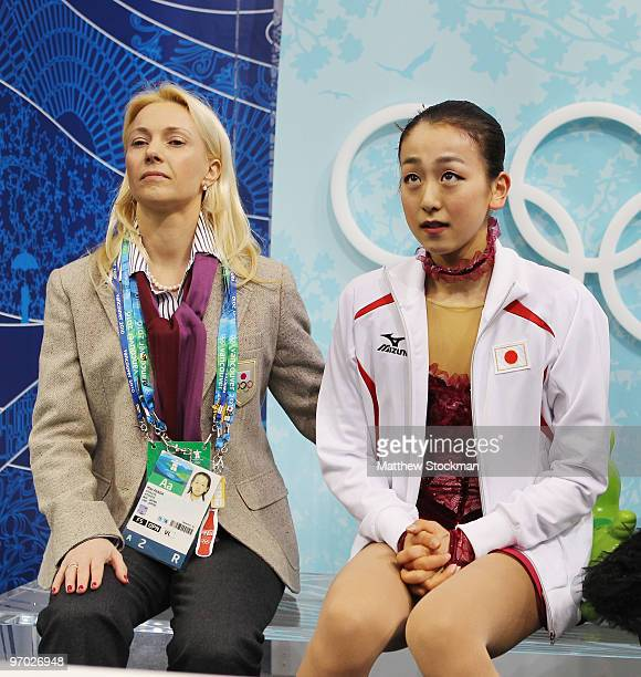Mao Asada of Japan sits in the kiss and cry area with one of her coaches Shanetta Folle during the Ladies Short Program Figure Skating on day 12 of...
