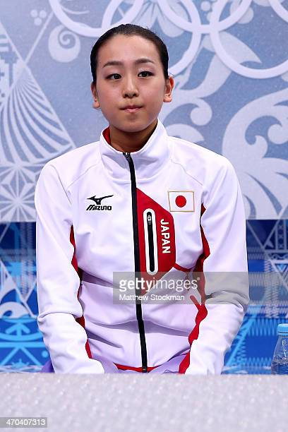 Mao Asada of Japan waits for her score in the Figure Skating Ladies' Short Program on day 12 of the Sochi 2014 Winter Olympics at Iceberg Skating...