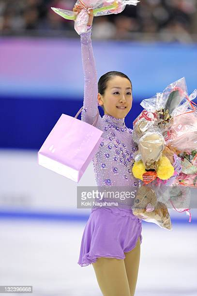 Mao Asada of Japan waves for fans during day two of the ISU Grand Prix of Figure Skating NHK Trophy at Makomanai Sekisui Heim Arena on November 12...