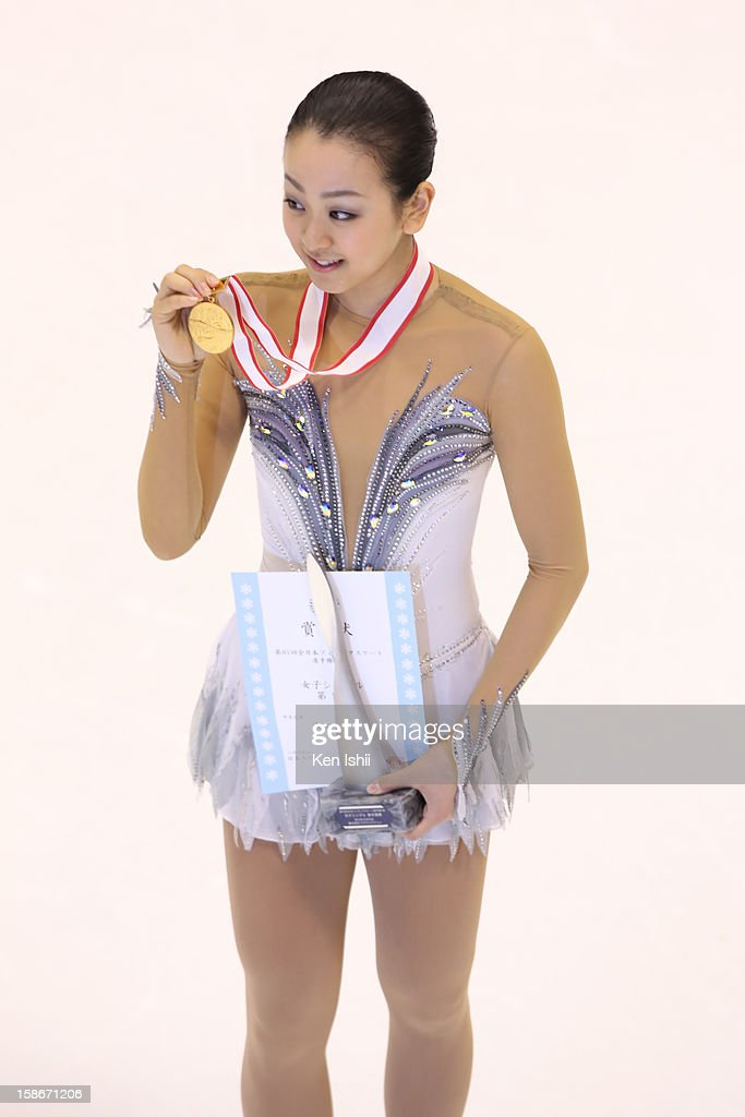 Mao Asada poses with gold medal after the Women's Free Program during day three of the 81st Japan Figure Skating Championships at Makomanai Sekisui Heim Ice Arena on December 23, 2012 in Sapporo, Japan.