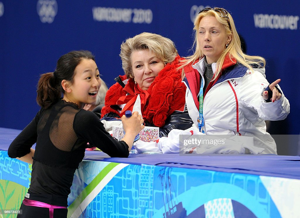 <a gi-track='captionPersonalityLinkClicked' href=/galleries/search?phrase=Mao+Asada&family=editorial&specificpeople=247229 ng-click='$event.stopPropagation()'>Mao Asada</a> smiles with her coach Tatiana Tarasova and assistant coach Shanetta Folle during a training session of the 2010 Vancouver Winter Olympics at Pacific Coliseum on February 21, 2010 in Vancouver, Canada.
