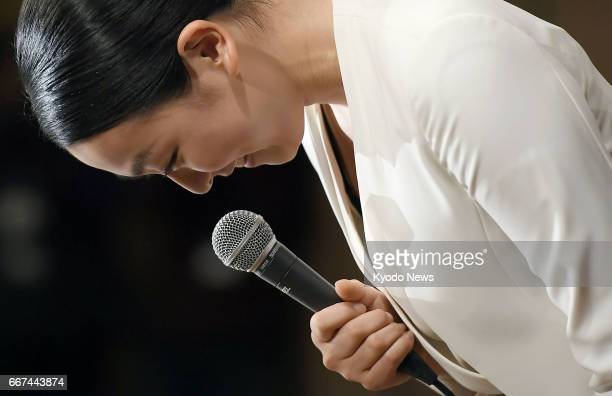 Mao Asada threetime world figure skating champion and silver medalist at the 2010 Vancouver Olympics bows after completing a press conference at a...