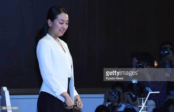 Mao Asada threetime world figure skating champion and silver medalist at the 2010 Vancouver Olympics completes a press conference with tears in her...