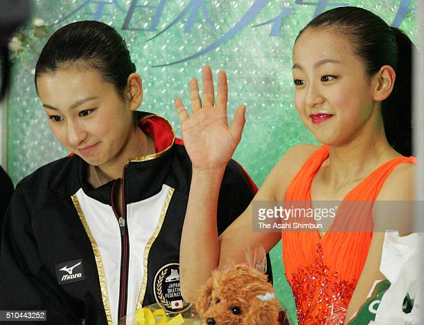 Mao Asada waits for her score after competing in the Women's Singles Short Program with her sister Mai Asada at the kiss and cry during day two of...