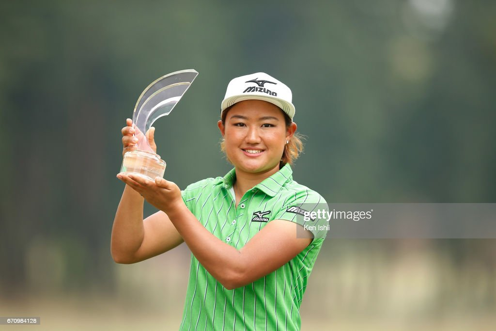Mao Nozawa holds a winner's trophy after the final round of the Panasonic Open Ladies at the Chiba Country Club on April 21, 2017 in Noda, Japan.