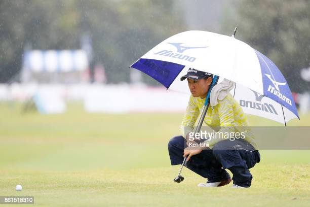 Mao Nozawa of Japan reads the green on the 17th hole during the final round of the Udonken Ladies at the Mannou Hills Country Club on October 15 2017...