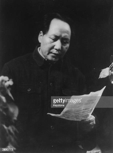 Mao Tsetung or Mao Zedong the Chinese Communist leader and first chairman of the People's Republic at a political meeting reading a report on...