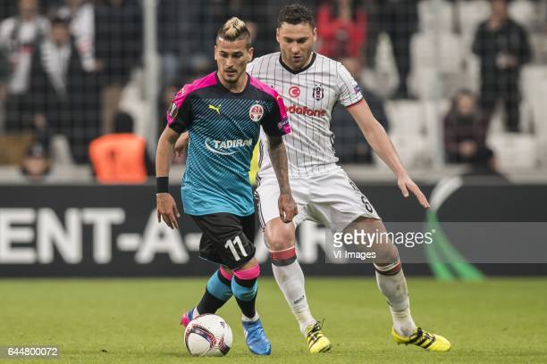 Maor Buzaglo of Hapoel Beer Sheva Dusko Tosic of Besiktas JKduring the UEFA Europa League round of 16 match between Besiktas JK and Hapoel Beer Sheva...
