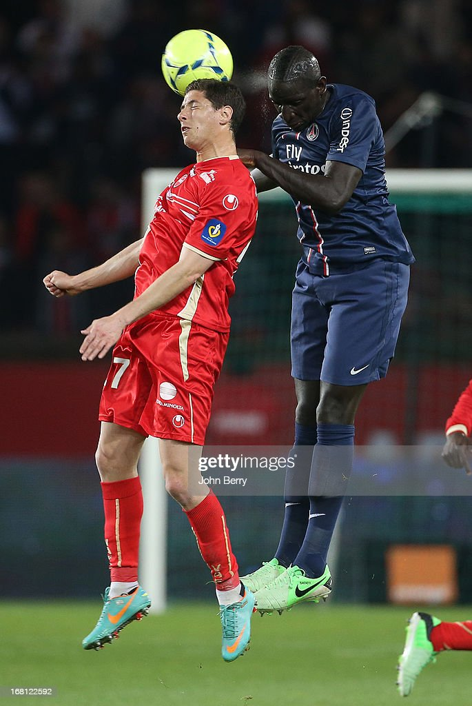 Maor Melikson of Valenciennes and <a gi-track='captionPersonalityLinkClicked' href=/galleries/search?phrase=Mamadou+Sakho&family=editorial&specificpeople=4154099 ng-click='$event.stopPropagation()'>Mamadou Sakho</a> of PSG in action during the Ligue 1 match between Paris Saint-Germain FC and Valenciennes FC at the Parc des Princes stadium on May 5, 2013 in Paris, France.