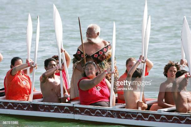Maori culture members salute Prime Minister Helen Clark from their waka as she watches from aboard Te Aurere during the Waitangi Day celebrations...