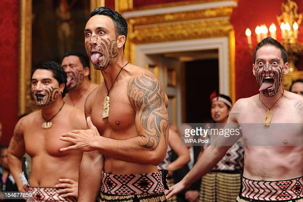 Maori dancers perform the traditional Haka for Prince Charles Prince of Wales and his wife Camilla Duchess of Cornwall at St James's Palace during a...