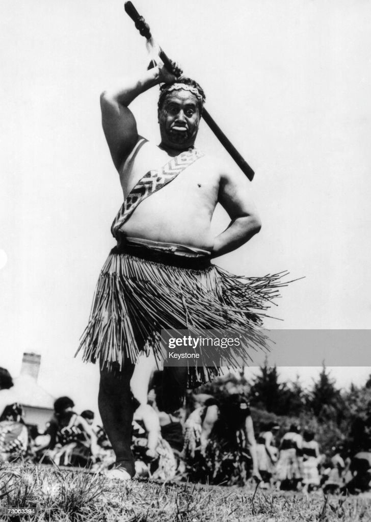 Maori Henare Toke performs a ceremonial 'challenge' to welcome Queen Elizabeth II at the start of her visit to Waitangi in the Bay of Islands, New Zealand, 5th January 1954.