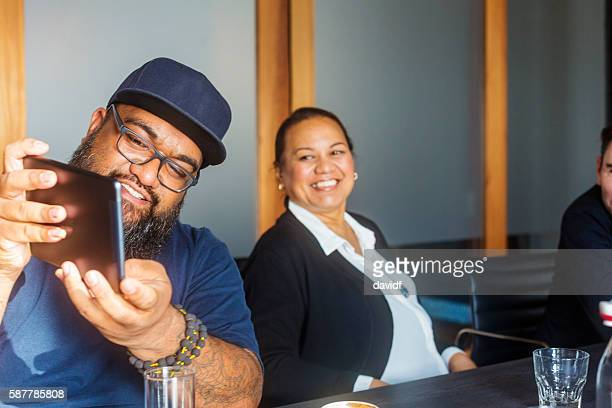 Maori Islander Man Using Tablet Computer in Business Meeting