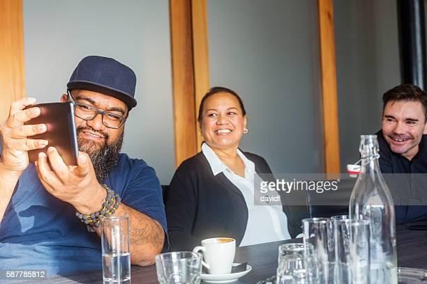 Maori Islander Man Using Tablet Computer in Business Meeting