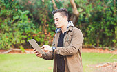 Maori using Tablet in outdoor setting.