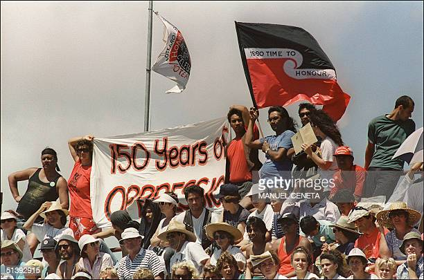 Maori protesters hold banners and streamers during the Waitanagi Day celebrations 06 February 1990 asking Queen Elizabeth II to honor the treaty of...