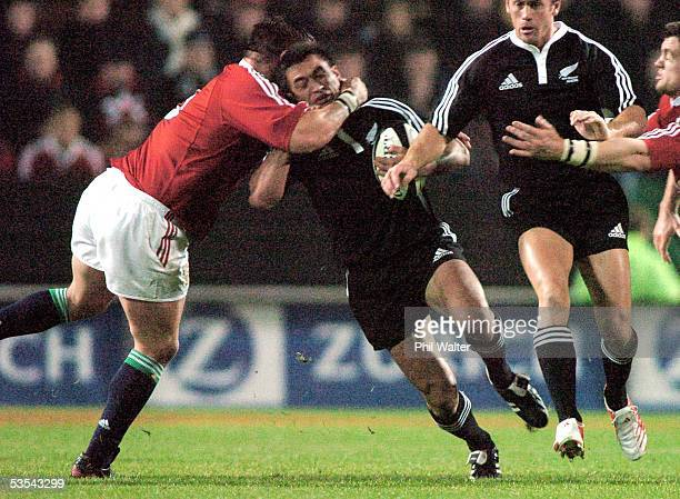 Maori Rua Tipoki is tackled high by British and Irish Lions Steve Thokmpson in their International Rugby match played at Waikato Stadium in Hamilton...