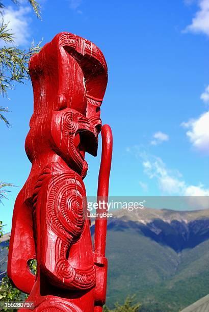 Maori Totem (Pou) looking out to distant Mountains