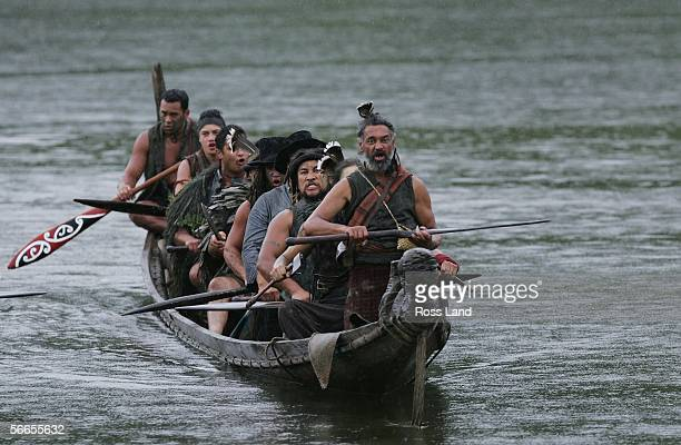 Maori warrior actors from the movie 'The River Queen' perform a Haka on Waka on the Whanganui River at the Premiere of The River Queen on January 24...
