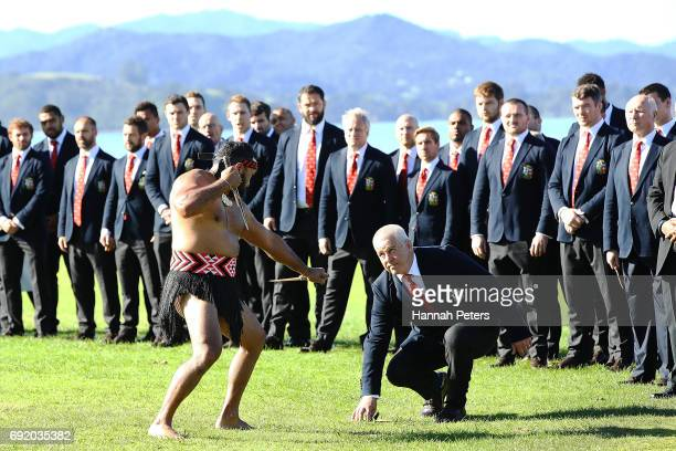 Maori warrior lays a challenge down for Head coach Warren Gatland of the Lions during the British Irish Lions Maori Welcome at Waitangi Treaty...