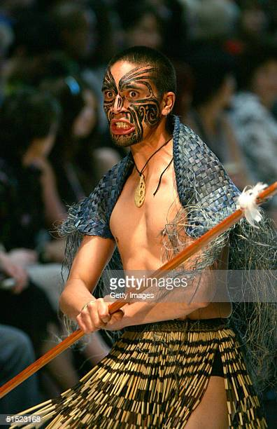 Maori warrior leads out the models for the display of autumn/winter 2005 creations from New Zealand fashion designer Paula Coulthard during the Air...