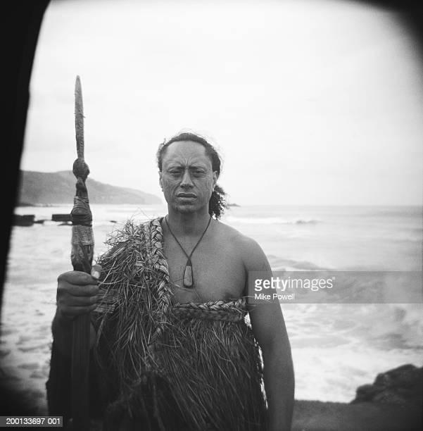Maori warrior wearing cloak, holding Taiaha (B&W)