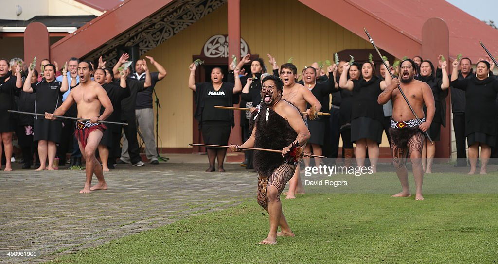 Maori warriors challenge the England team in their traditonal welcome during the vist to the Te iti o Haua Marae by the England Rugby Team on June 21, 2014 in Hamilton, New Zealand.