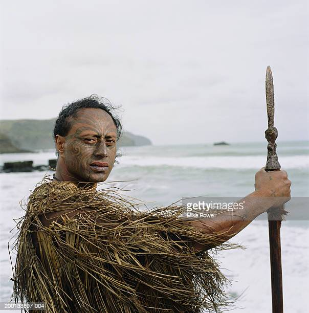 Maori warror wearing  cloak, holding Taiaha, portrait