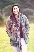Young maori woman smiling.