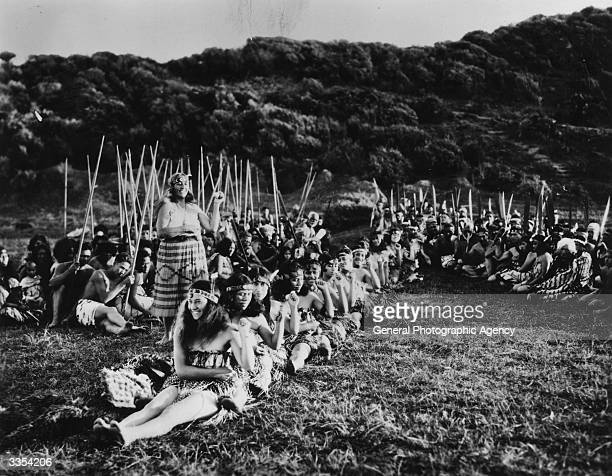 Maori women in a ritual scene pretending to be in a canoe a scene from the film 'Under The Southern Cross' A Universal Pictures film also known as...